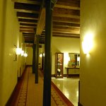 Hotel corridor. Iron columns and wood beams