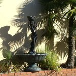 Entrance fountain and palms
