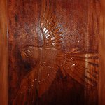 Macaw carved into the door in the downstairs Rancho