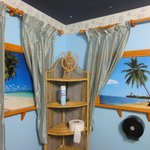 Beach-themed toilet, complete with ocean sounds