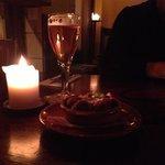 Spanish meatballs and glass of belgian beer
