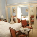 The bedroom area of the Forfait suite, good size, great bed, storage and light