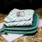 Salt/pepper, dish cloths, cutting board, oven heat pad