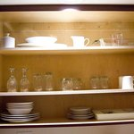 China available in one of the closet space above the sink in the kitchen