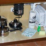More kitchen equipment underneath the sink