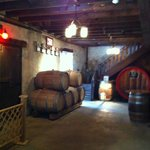 Winery tour: Underground storage of oak barrels for aging.