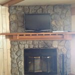 fireplace & TV with free DVDs from front desk