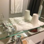 "3"" glass shelf is sufficient for a cup and a toothbrush. Use the toilet seat f"
