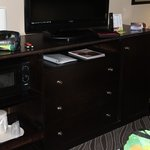 Room 115. TV Cabinet has small microwave and fridge