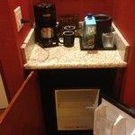 Coffee maker, Fiji water, mini-fridge
