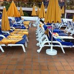 plenty of reserved sun beds with no people on them!