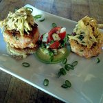 Fresh salmon and cornmeal cakes with a cabbage salad and avocado garnish