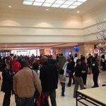 crowds watching Inaugural address on lobby TVs