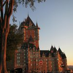 Chateau Frontenac across the park in golden sunlight