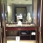 Bathroom w/ built in television mirror