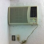 old, dirty, noisy air conditioner