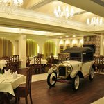 The vintage car in the middle of the main dining area