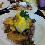 poached eggs mushrooms hollandaise sauce with sour dough bread.