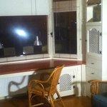 bay window room with desk