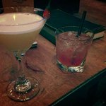 Martini-esque drink on the left with honey and hot pepper; strawberry/basil on the right