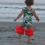 Silly little girl..loves the beach
