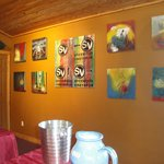 Vineyard tasting room's wall of local artists' interesting, colorful oil paintings