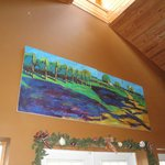 Wall mural over the tasting room's doorway ~ bold blues, teal greens, & purples oil paints.