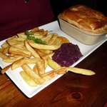 Steak and merlot pie with chips and red cabbage.