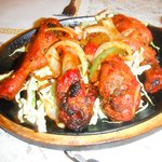 sizzling tandoori chicken served to your table