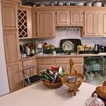large kitchen, refrigerator stocked with complimentary items