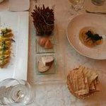 Pasta dishes with bread basket.  Chilli/cinnamon table decoration