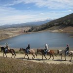 Year-Round Trail Rides! Here the Reservoir with the Continental Divide providing a stunning back