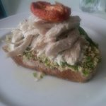 Open faced chicken sandwich with hummus, tzatziki and tabouleh