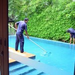 Staff cleaning the pool