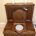 the wooden commode