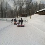 pulling the kids up the kiddie tubing hill