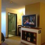 looking from living area towards bathroom/vanity area (past tv)