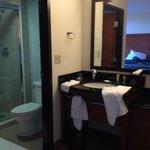 vanity/bathroom area - bed in mirror