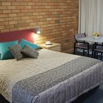 Large queen beds throughout all rooms.