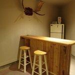 Pool table room with bar/fridge & dart board
