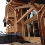 back of chalet and hot tub