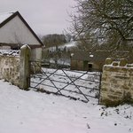 Cefnmeurig's stone barns in the snow.