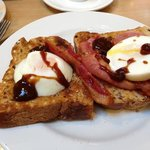 Poached egg and bacon on brown toast. The only way to start the day! (brown sauce optional)