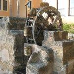 Old water wheel near car park