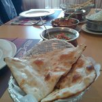 The food on our table. Note no infused garlic in these naans