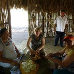 Making tortilla's in a traditional Mayan kitchen