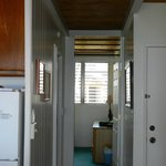 Unit #203 View from kitchen down hall to main floor bedroom