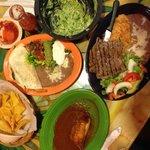 From the top and going clockwise: fresh guacamole, carne asada, tamale and fajita quesadilla.