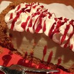 key lime pie with raspberry drizzle to complete a delicious meal.