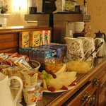 the lovely spread of fruits,cereals,yogurts,juices, milk